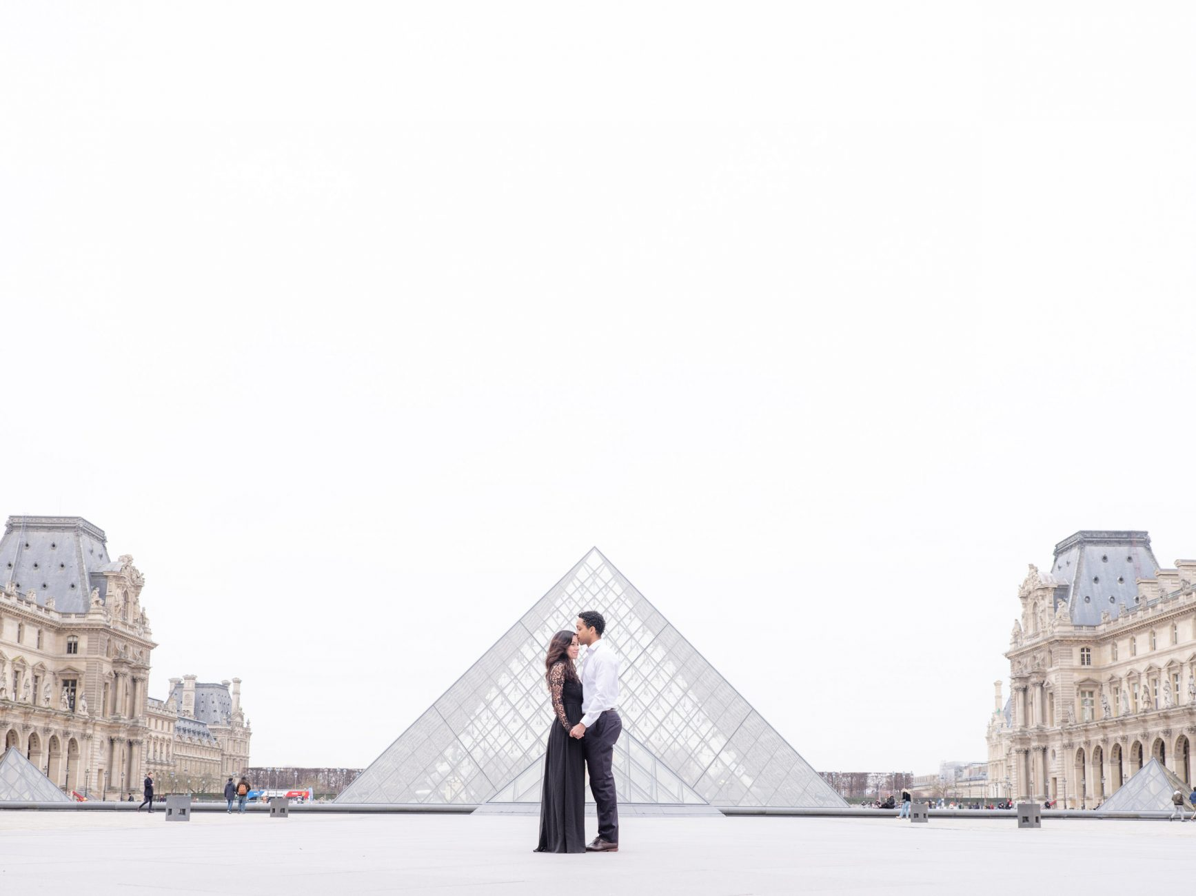 couple positioned in the middle of a paris square