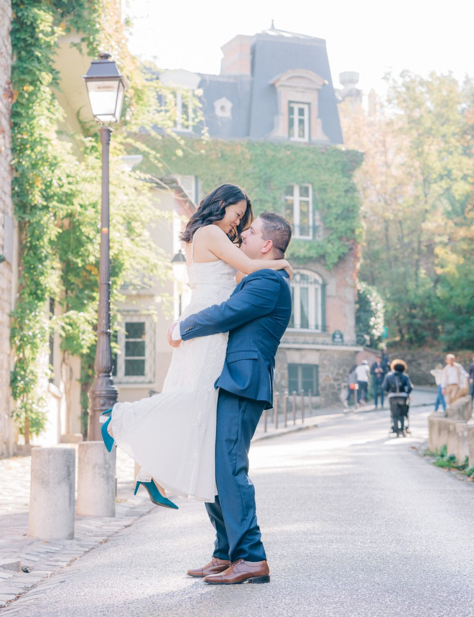 husband holds wife during wedding day in paris