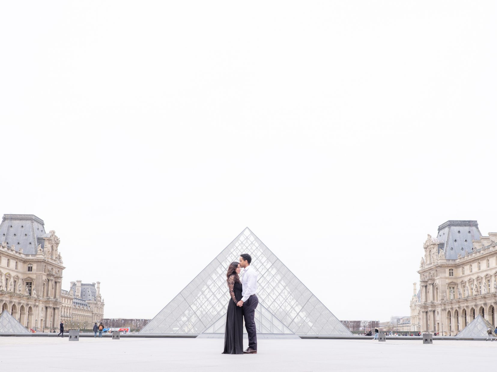 posing in the center of a square in paris
