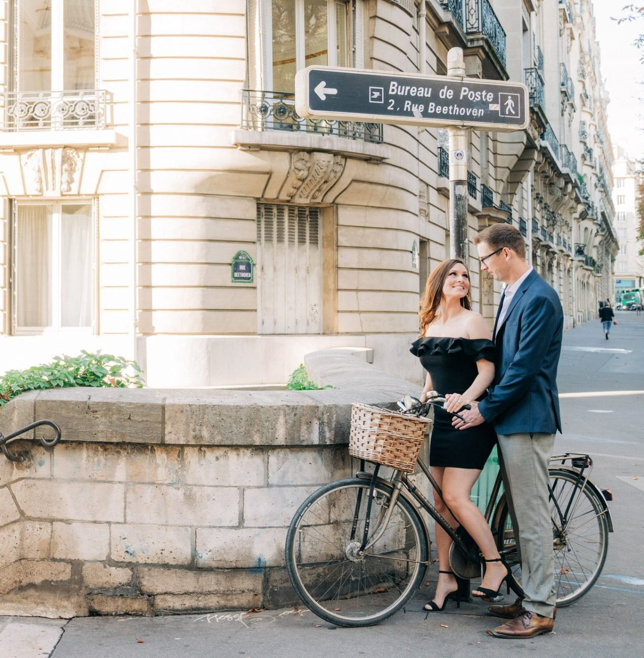 black dress blue blazer with bike in paris