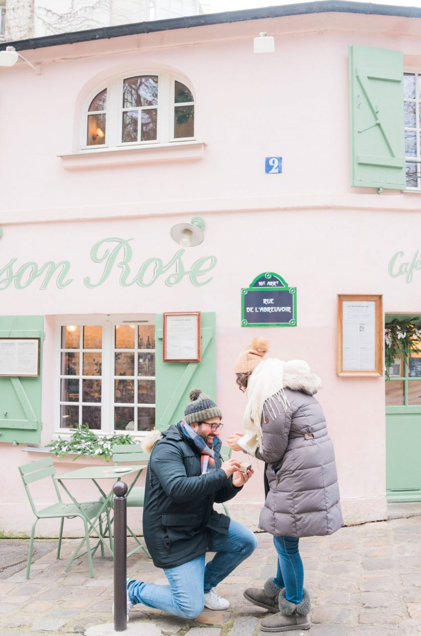 man on one knee proposing marriage in montmartre paris france